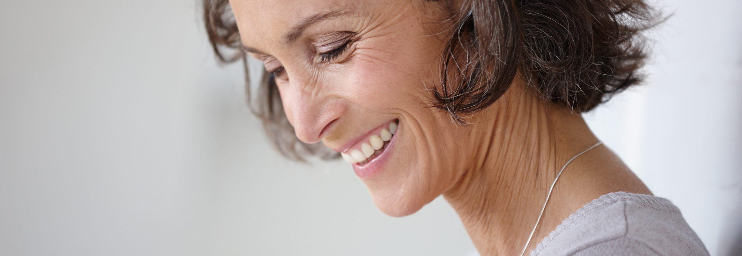 Frau war bei der Wurzelbehandlung in Sauerlach und freut sich über Zahnerhalt
